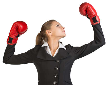 muffle: Businesswoman wearing boxing gloves, with her arms forward up, her head turned sideways. Isolated over white background