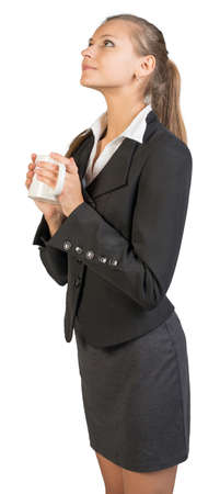 looking ahead: Businesswoman holding mug, looking ahead and upwards. Isolated over white background