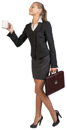 Businesswoman holding white mug at distance and briefcase, smiling. Isolated over white background photo