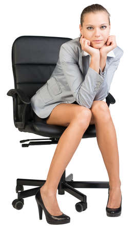 half turn: Businesswoman on office chair, looking at camera, with her head reclined upon her hands. Isolated over white background