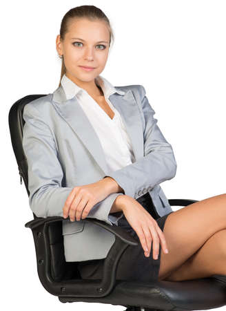 half turn: Businesswoman on office chair, looking at camera, her arms on armrest. Isolated over white background