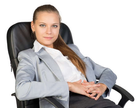 lean back: Businesswoman back in office chair, looking at camera cheerfully, with her hands clasped over her stomach. Isolated over white background