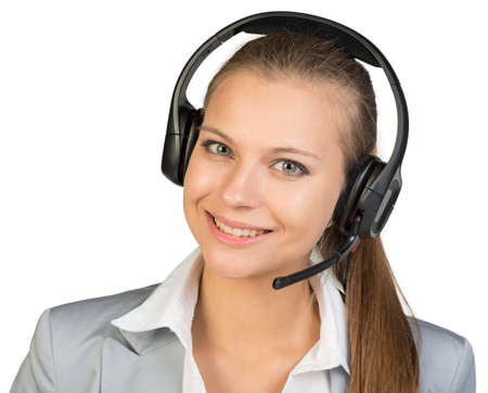 head tilted: Businesswoman in headset, her head tilted slightly to the side, looking at camera, smiling. Isolated over white background Stock Photo