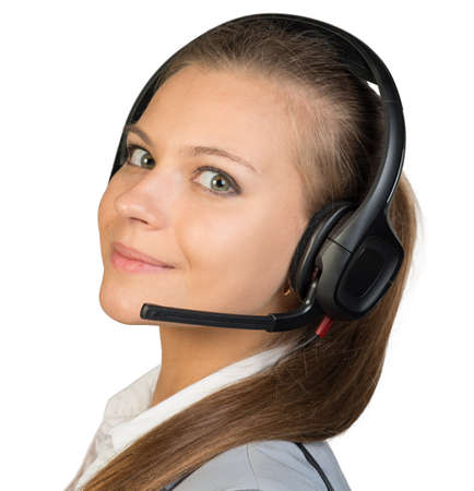 half turn: Businesswoman in headset with her head half-turned to camera, looking at camera, smiling. Isolated over white background Stock Photo