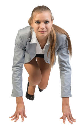 Businesswoman standing in running start pose, front view. Isolated over white background photo