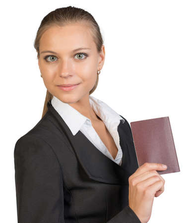 half turn: Businesswoman showing passport with blank cover, looking at camera. Isolated over white background
