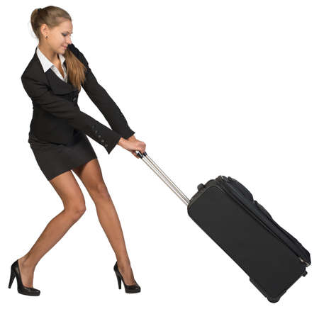 dragging: Businesswoman dragging heavy wheeled suitcase with both hands. Isolated over white background Stock Photo