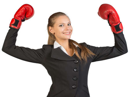 to muffle: Businesswoman wearing boxing gloves standing in victory pose, looking at camera, smiling. Isolated over white background Stock Photo