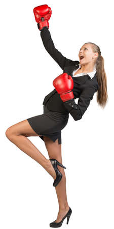 Businesswoman wearing boxing gloves expressing rapture. Isolated over white background photo