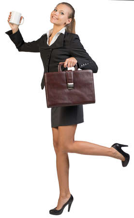 exult: Businesswoman with white mug and briefcase, expressing rapture, looking at camera. Isolated over white background