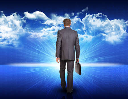 briefcase: Businessman with briefcase walking against digitally generated spacy blue landscape with rising sun and cloudy sky