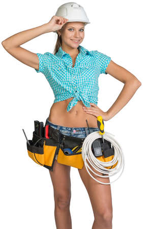cat5: Woman wearing hard hat and tool belt, with coil of cable at her waist, her hand at the bill, looking at camera, smiling. Isolated on white background