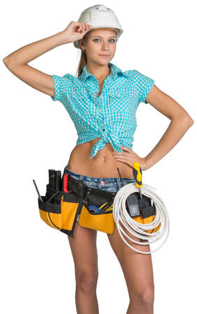 cat5: Woman wearing hard hat and tool belt, with coil of cable at her waist, her hand at the bill, looking at camera. Isolated on white background