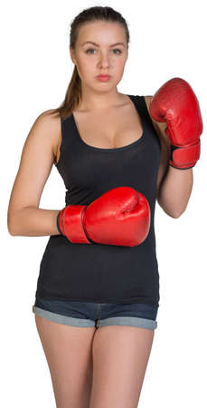 to muffle: Woman in boxing gloves posing, looking at camera. Isolated on white background Stock Photo