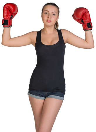 muffle: Woman in boxing gloves posing with her arms up, looking at camera. Isolated on white background