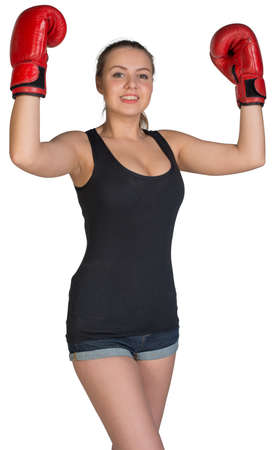 to muffle: Woman in boxing gloves posing with her arms up, looking at camera. Isolated on white background