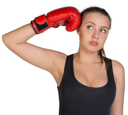 to muffle: Woman holding boxing glove at her temple, looking to her right. Isolated on white background Stock Photo