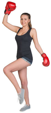 to muffle: Woman in boxing gloves posing, looking at camera, smiling. Isolated on white background Stock Photo