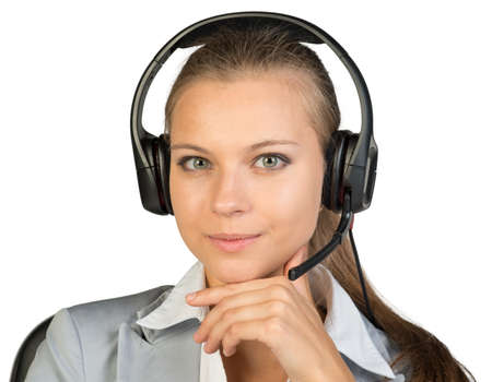 all right: Businesswoman in headset sitting on chair, hand under chin, looking at camera. Isolated over white background