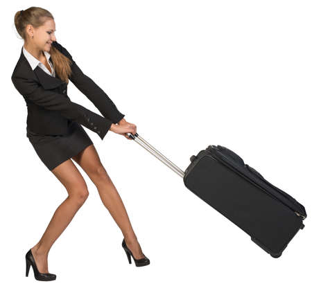 dragging: Businesswoman dragging heavy wheeled suitcase at utmost strain. Isolated over white background