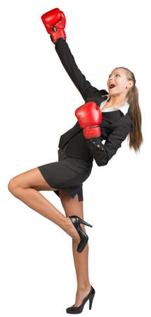 rapture: Businesswoman wearing boxing gloves expressing rapture. Isolated over white background
