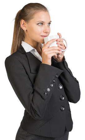 half turn: Businesswoman holding mug at her mouth. Isolated over white background Stock Photo