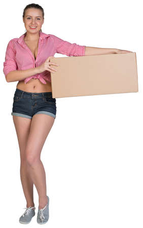 Woman holding cardboard box, looking at camera, smiling. Isolated on white background photo