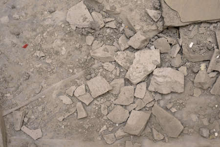 Demolished concrete floor, close up. Gray background