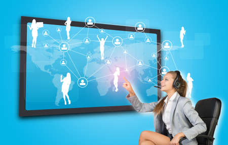 half turn: Businesswoman in headset using touch screen interface featuring world map, network of person icons and female silhouettes, on blue background