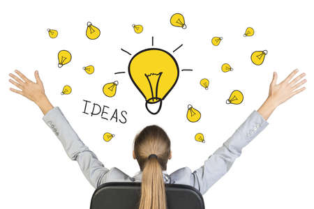 Businesswoman sitting on office chair with her hands outstretched, in front of hand drawn lamps with word Idea, on white background photo