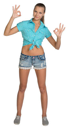 Pretty girl in shorts and shirt showing ok hand signs. Full length. Isolated over white background photo