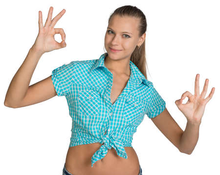 Pretty girl in shirt showing ok hand signs. Full length. Isolated over white background photo