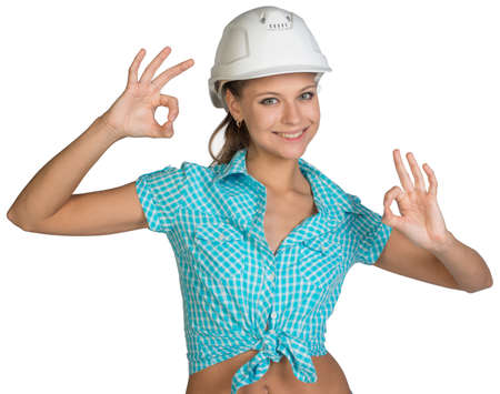 Pretty girl in shirt and white helmet showing ok hand signs. Full length. Isolated over white background photo
