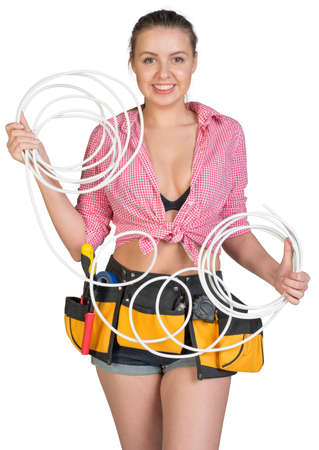 cat5: Sexy woman wearing tool belt, with coil of power cable on her shoulder, holding coil of cat 5, looking at camera, smiling. Isolated on white background