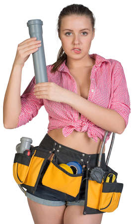 braided flexible: Woman in tool belt holding fitting pipe, biting her lip, looking at camera. Isolated on white background Stock Photo