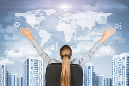 other world: Businesswoman sitting with her hands outstretched against urban background with world map above and other virtual elements