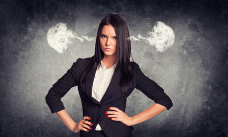 angry women: Concrete gray wall with fissure. Wicked woman in suit with steam from ears