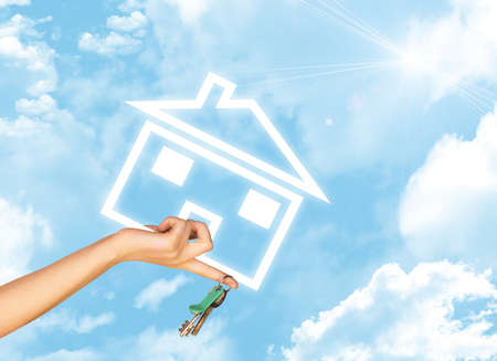 hand holding house: Hand holding house icon and key. Background of blue sky, clouds and sun
