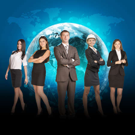 Business people in suits standing on background of Earth. World map on dark background. Elements of this image furnished by NASA photo