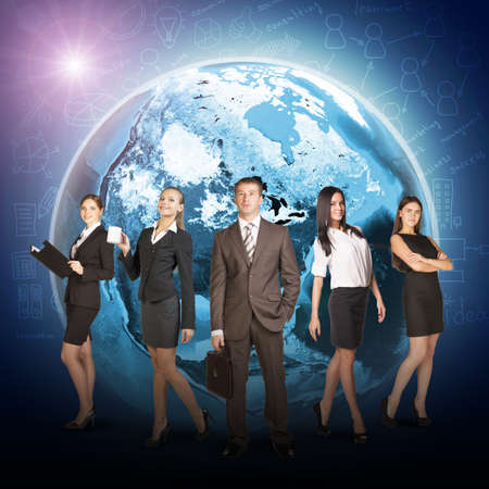 Business people in suits standing on background of Earth. Elements of this image furnished by NASA photo
