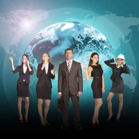 businessman shoes: Business people in suits standing on background of Earth. World map on dark background.