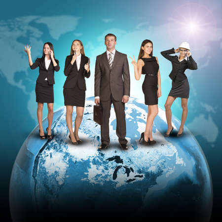 Business people in suits standing on Earth. World map on dark background. photo