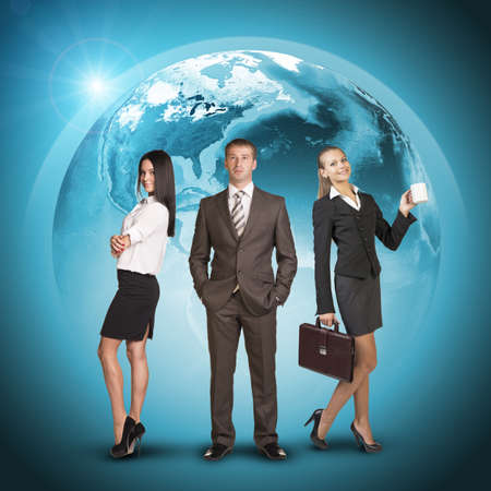 Business people in suits standing on background of Earth. World map on dark background.  photo