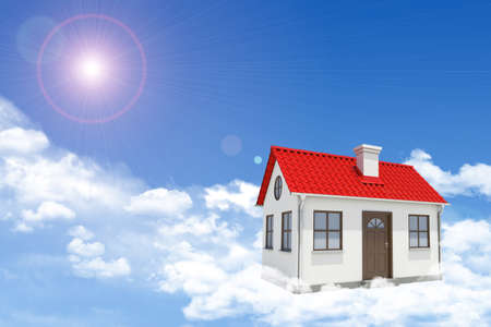 gable house: White house with red gable roof, brown door and chimney in clouds. Background sun shines brightly. Blue sky Stock Photo