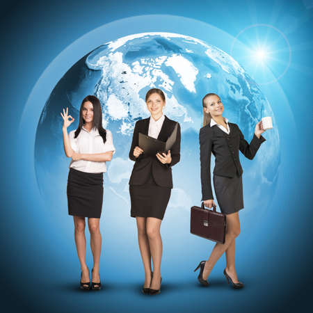 skirts: Business womens in suits, blouses, skirts, smiling and looking at camera. Against background of globe earth.
