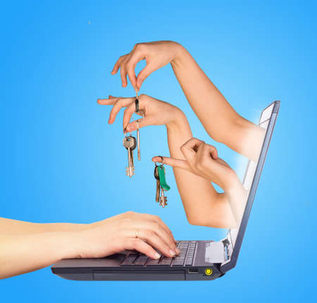 rom: Keys holding in fingers from monitor screen. Hands typing on keyboard. Blue background