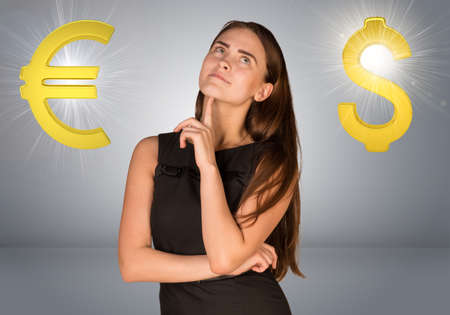 euro sign: Business woman thinking over dollar sign and euro sign. Gray gradient background