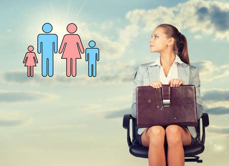 Business woman in skirt, blouse and jacket, sitting on chair and holding briefcase imagines family. Against background of sky and clouds