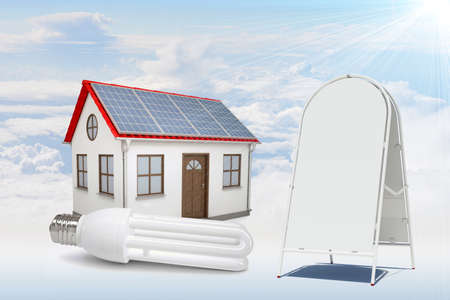 socle: White house with red roof, brown door and solar panels in clouds. Near with house sidewalk sign. Background sun shines brightly on large clouds Stock Photo