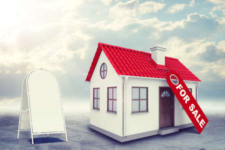 sidewalk sale: White house with label for sale, red roof, brown door and chimney. Near with house sidewalk sign. Near with house sidewalk sign. Background sun shines brightly on large clouds Stock Photo